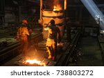 two steelworkers at the steel... | Shutterstock . vector #738803272