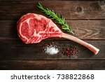 raw tomahawk steak on wooden... | Shutterstock . vector #738822868