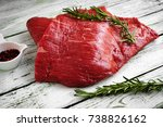 Small photo of raw fillet of beef brisket on white wooden background