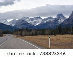 Empty Canadian highway through the snow capped Rocky Mountains