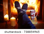 man's feet in warm socks with... | Shutterstock . vector #738854965