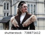 vintage girl in the autumn city | Shutterstock . vector #738871612