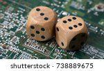 Two Wooden Dice On A Green...
