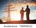 silhouette of two engineers... | Shutterstock . vector #738900412