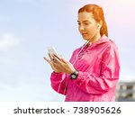sporty woman with earphones on... | Shutterstock . vector #738905626