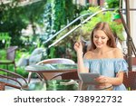 young woman with tablet and... | Shutterstock . vector #738922732