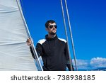 man in black on the yacht | Shutterstock . vector #738938185