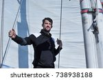 man in black on the sailboard... | Shutterstock . vector #738938188