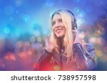 beautiful girl listening to... | Shutterstock . vector #738957598