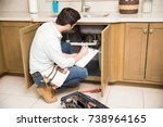 rear view of a male plumber... | Shutterstock . vector #738964165