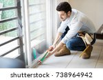 young handyman wearing a tool... | Shutterstock . vector #738964942