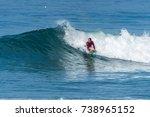 bodyboarder surfing ocean wave... | Shutterstock . vector #738965152