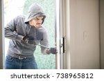male burglar wearing a hoodie... | Shutterstock . vector #738965812