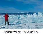 male tourist in red jacket is... | Shutterstock . vector #739035322