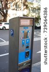 Small photo of Sydney, Australia - October 17, 2017: Parking pay and display ticket machine paying by credit card or cash on Albion street, property of City of Sydney council