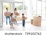 happy family with moving boxes...   Shutterstock . vector #739102762