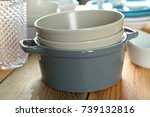 stack of dishes on table | Shutterstock . vector #739132816