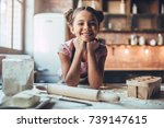 little cute girl is cooking on... | Shutterstock . vector #739147615