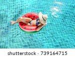 woman bikini swimming pool on... | Shutterstock . vector #739164715
