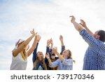 friends playing volleyball | Shutterstock . vector #739170346