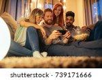 a group of friends enjoying a... | Shutterstock . vector #739171666