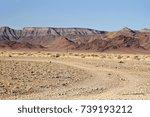 a dirt road cuts through the...   Shutterstock . vector #739193212