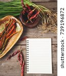 Small photo of Allium tuberosum kimchi with blank notepad