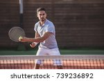 Handsome man is playing tennis...