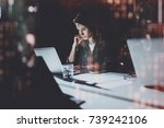 young woman working at night... | Shutterstock . vector #739242106