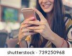 woman's hand using smart phone. ...   Shutterstock . vector #739250968