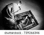 muslim woman praying for allah... | Shutterstock . vector #739266346
