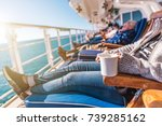 Deckchairs Cruise Ship Relax. Cruise Guest Relaxing in the Sun. Commercial Maritime Theme. - stock photo