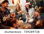 group of friends laughing on... | Shutterstock . vector #739289728