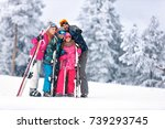 family together skiing on snowy ... | Shutterstock . vector #739293745