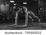 woman exercising in the gym ... | Shutterstock . vector #739303522