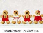 Row Of Gingerbread Men Against...
