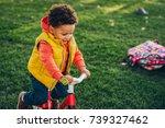 outdoor portrait of cute little ... | Shutterstock . vector #739327462