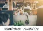 call center worker accompanied... | Shutterstock . vector #739359772