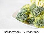 fresh raw broccoli on a light... | Shutterstock . vector #739368022
