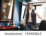 male hairstylist in barbershop. ... | Shutterstock . vector #739403815