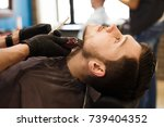 barber styling beard with... | Shutterstock . vector #739404352