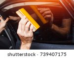 master installs tint film for... | Shutterstock . vector #739407175