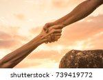 giving a helping hand. | Shutterstock . vector #739419772