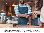closeup of a barista using nfs... | Shutterstock . vector #739423228