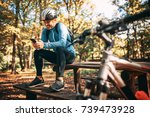 happy male cyclist sitting in... | Shutterstock . vector #739473928