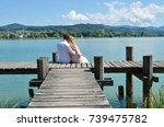 a couple on the wooden jetty at ... | Shutterstock . vector #739475782