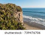 beautiful cliffside beach view... | Shutterstock . vector #739476706