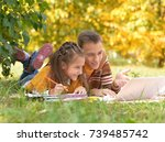 little girl looking at laptop | Shutterstock . vector #739485742