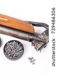 Small photo of Box with metal air gun pellets and air gun with wooden gunstock