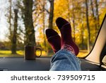 autumn car trip. man feet in... | Shutterstock . vector #739509715